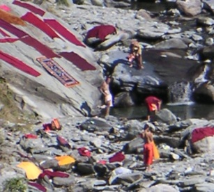 Tibetan monks washing their robes in Bhagsu River